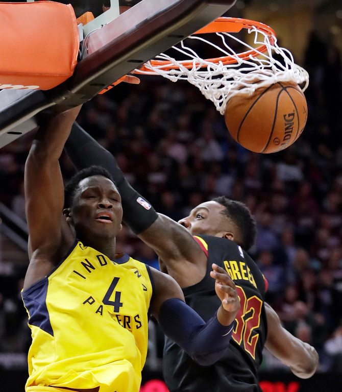 . Indiana Pacers\' Victor Oladipo (4) dunks against Cleveland Cavaliers\' Jeff Green (32) during the second half of Game 2 of an NBA basketball first-round playoff series Wednesday, April 18, 2018, in Cleveland. The Cavaliers won 100-97. (AP Photo/Tony Dejak)