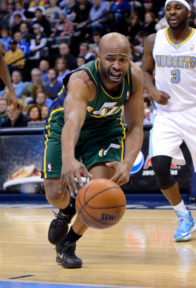 . Utah Jazz point guard Jamaal Tinsley chases a loose ball during the third quarter of an NBA basketball game against the Denver Nuggets, Saturday, Jan. 5, 2013, in Denver. (AP Photo/Jack Dempsey)