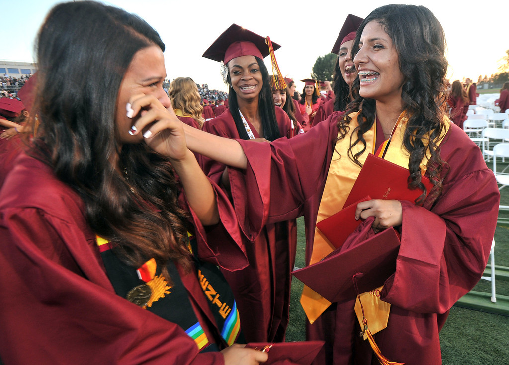 . Stephanie Aguayo (right) wipes tears away from Emily Apodaca (left) after La Serna High School\'s 51st Annual Commencement at La Mirada High School stadium in La Mirada on Thursday June 13, 2013. La Serna marked the commencement of 635 graduates and marking Principal Ann Fitzgerald\'s first graduation as principal. (SGVN/Staff Photo by Keith Durflinger)
