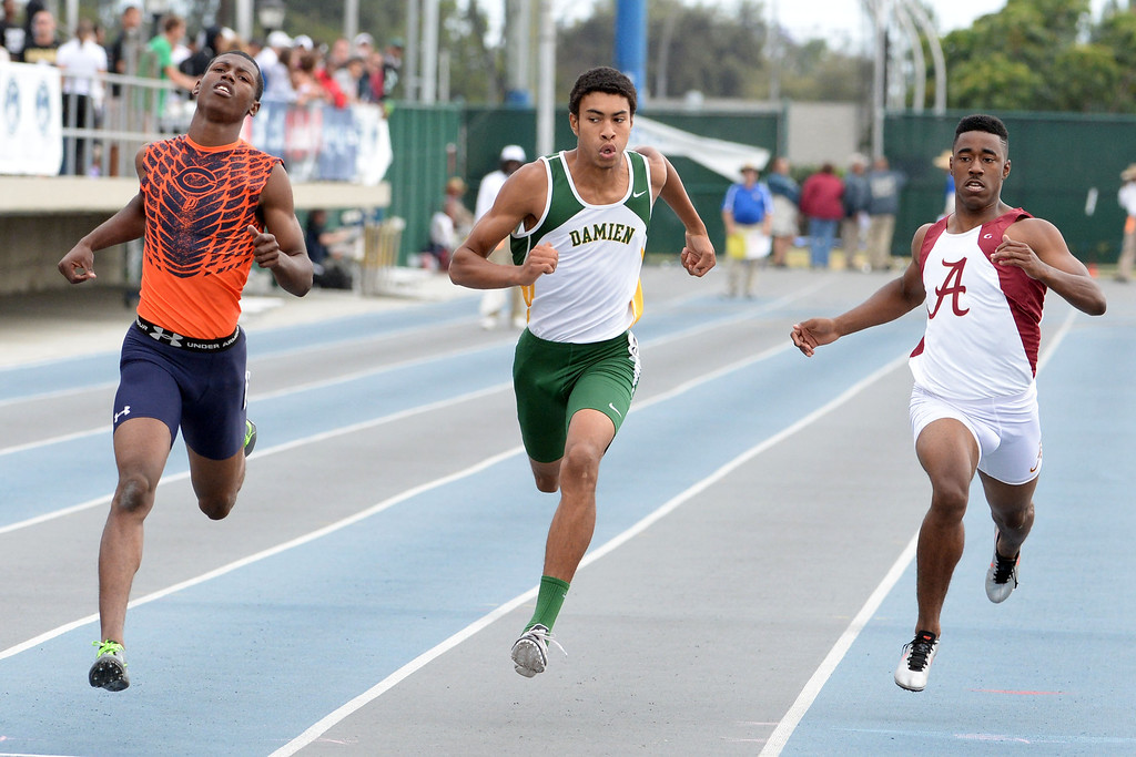 . Damien\'s Thaddeus Smith, center, competes in the division 3 200 meters race during the CIF Southern Section track and final Championships at Cerritos College in Norwalk, Calif., Saturday, May 24, 2014.   (Keith Birmingham/Pasadena Star-News)