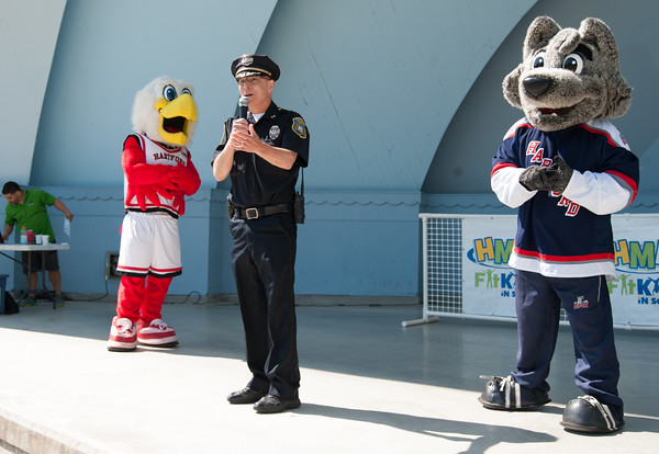 05/24/18 Wesley Bunnell | Staff New Britain Police Chief James Wardwell, an avid runner, stands in the clamshell at Walnut Hill Park surrounded by mascots Howie the Hawk from the University of Hartford and Sonar from the Hartford Wolfpack to speak about the importance of running in staying physical fit. The Hartford Marathon Foundation hosted the area schools on Medal Day at Walnut Hill Park as the culmination of their HMF Fit Kids program. The program is a 6 week goal oriented running program for elementary and middle school students to help develop a healthy and active lifestyle.