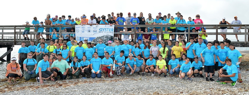 hri-faculty-and-student-volunteers-pose-for-a-group-photo-at-the-oyster-reef-restoration-project-held-at-goose-island-state-park_14182671992_o.jpg