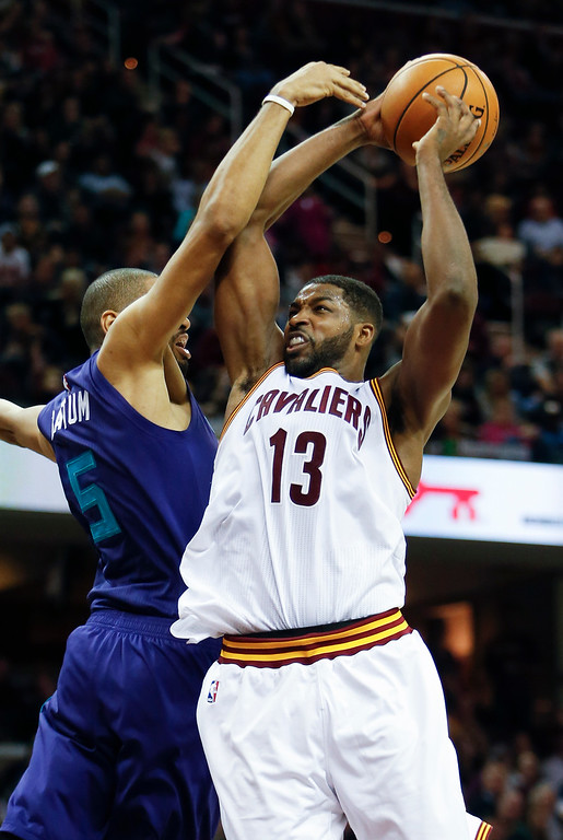. Cleveland Cavaliers\' Tristan Thompson (13) goes up for a shot against Charlotte Hornets\' Nicolas Batum (5) during the first half of an NBA basketball game Sunday, Nov. 13, 2016, in Cleveland. (AP Photo/Ron Schwane)