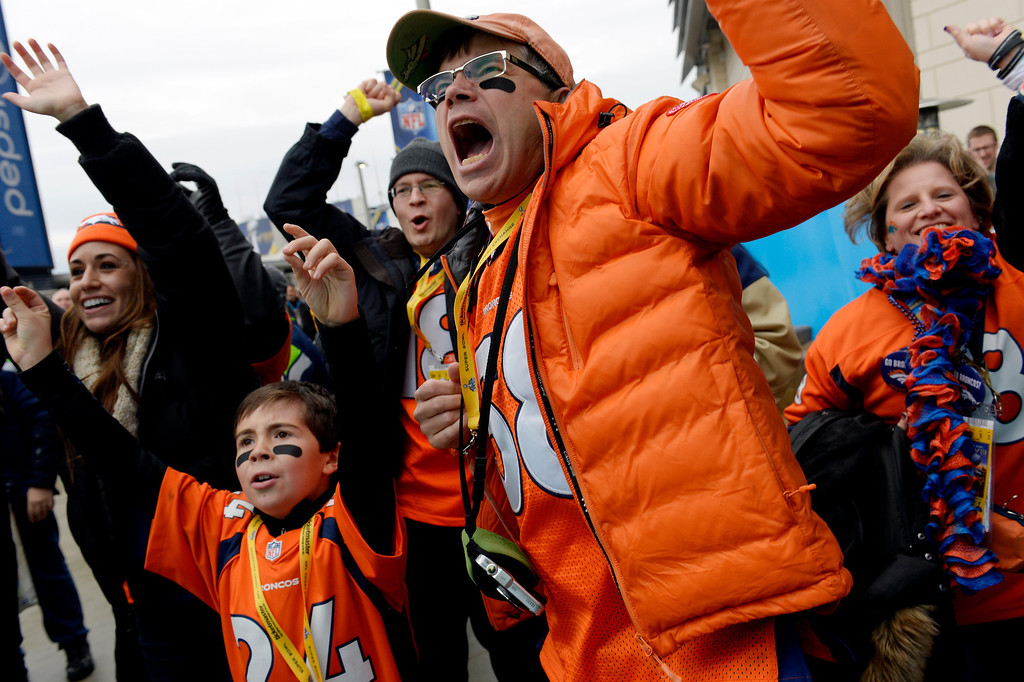 . Greg Kirk and his son Benjamin, age 10, cheer for the Broncos outside of the stadium prior to the game.  The Denver Broncos vs the Seattle Seahawks in Super Bowl XLVIII at MetLife Stadium in East Rutherford, New Jersey Sunday, February 2, 2014. (Photo by Craig Walker/The Denver Post)