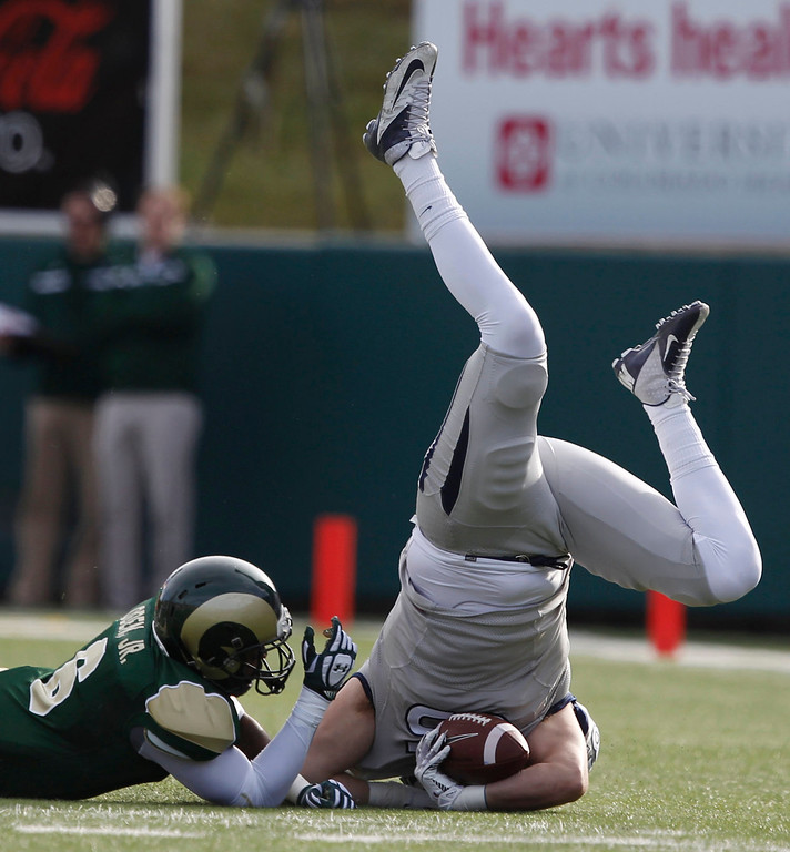 . Nevada tight end Randy Horton, right, is tripped up by Colorado State\'s Jasen Oden in the first half of an NCAA college football game in Fort Collins, Colo., on Saturday, Nov. 9, 2013. (AP Photo/David Zalubowski)