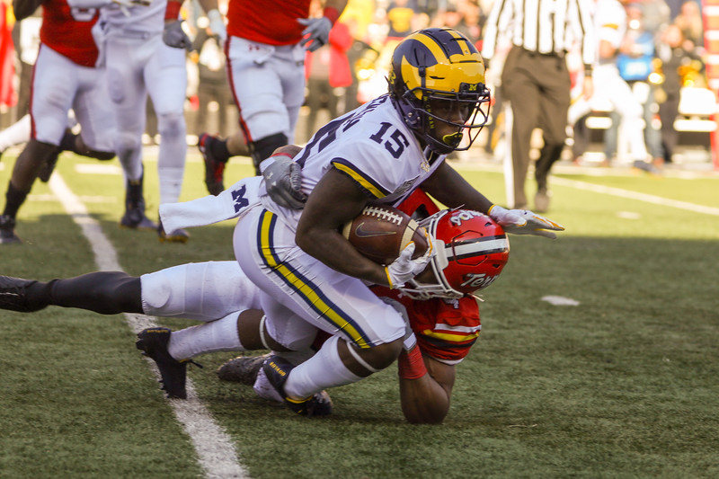 Michigan WR Giles Jackson is brought down by Maryland LB Keandre Jones.