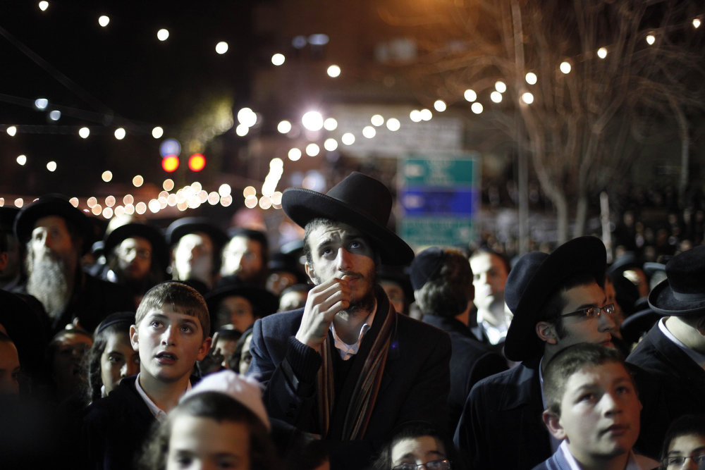 Description of . Ultra Orthodox Jews gather during an anti-election rally in the conservative Mea Shearim neighbourhood on January 20, 2013 in Jerusalem, Israel. The Israeli general election will be held on January 22.  (Photo by Lior Mizrahi/Getty Images)