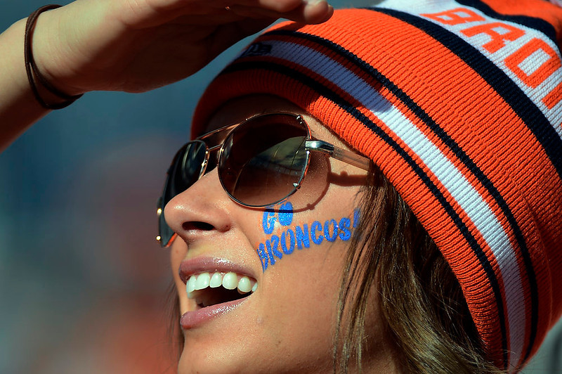 . Katie Schaefer, age 25, of Sioux Falls, South Dakota enjoys the sun prior to the game.  The Denver Broncos vs The Tampa Bay Buccaneers at Sports Authority Field Sunday December 2, 2012. John Leyba, The Denver Post