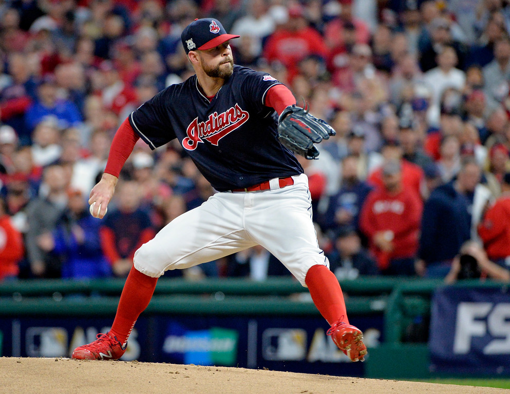 . Cleveland Indians starting pitcher Corey Kluber delivers in the first inning against the New York Yankees in Game 5 of a baseball American League Division Series, Wednesday, Oct. 11, 2017, in Cleveland. (AP Photo/Phil Long)