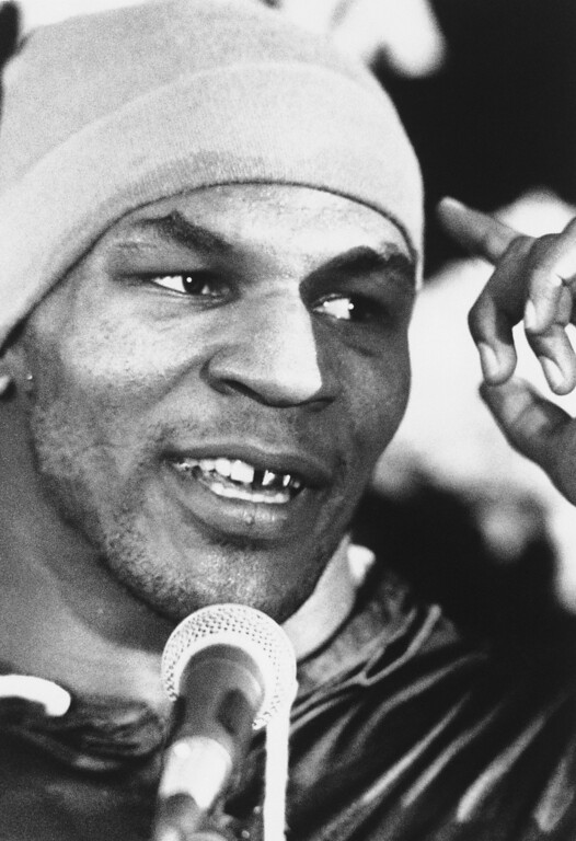 . Champ Mike Tyson talks to reporters in Atlantic City, New Jersey, Friday, Jan. 23, 1988 after retaining his Heavyweight Championship by defeating challenger Larry Holmes. (AP Photo/Paul Burnett)