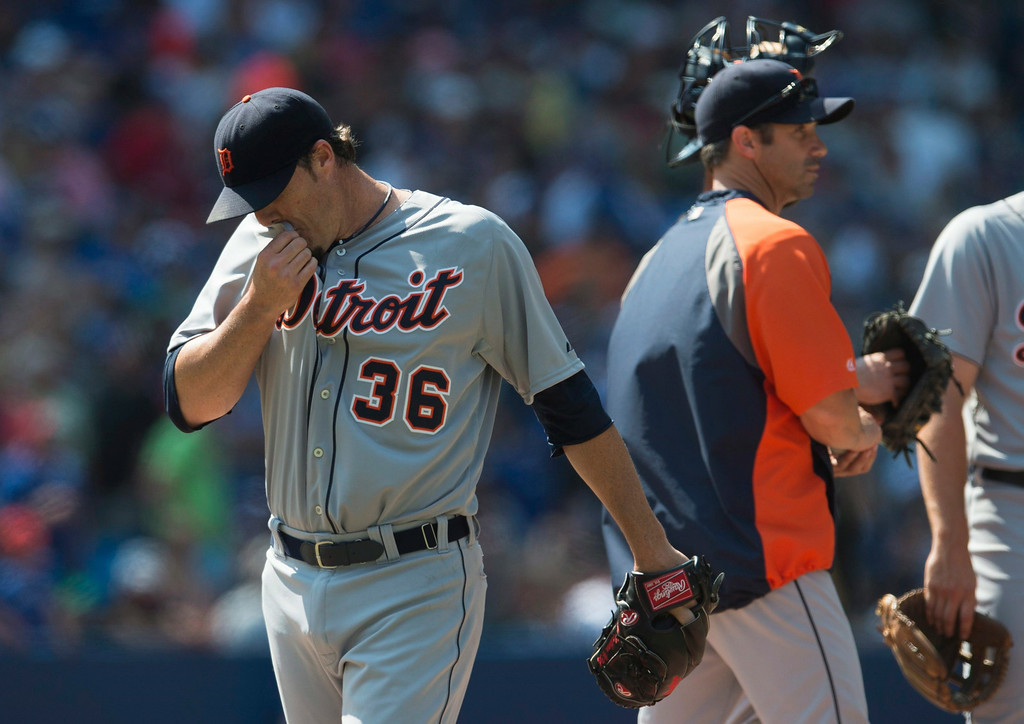 . Detroit Tigers closer Joe Nathan, left, walks off the mound past manager Brad Ausmus after blowing a save opportunity in the ninth inning of a baseball game against the Toronto Blue Jays, Saturday, Aug. 9, 2014 in Toronto. The Blue Jays defeated the Tigers 3-2. (AP Photo/The Canadian Press, Darren Calabrese)