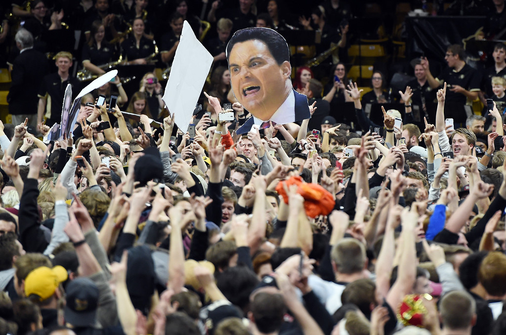 . Colorado fans storm the court after Colorado defeated Arizona 75-72 in an NCAA college basketball game Wednesday, Feb. 24, 2016, in Boulder, Colo. (AP Photo/Cliff Grassmick)