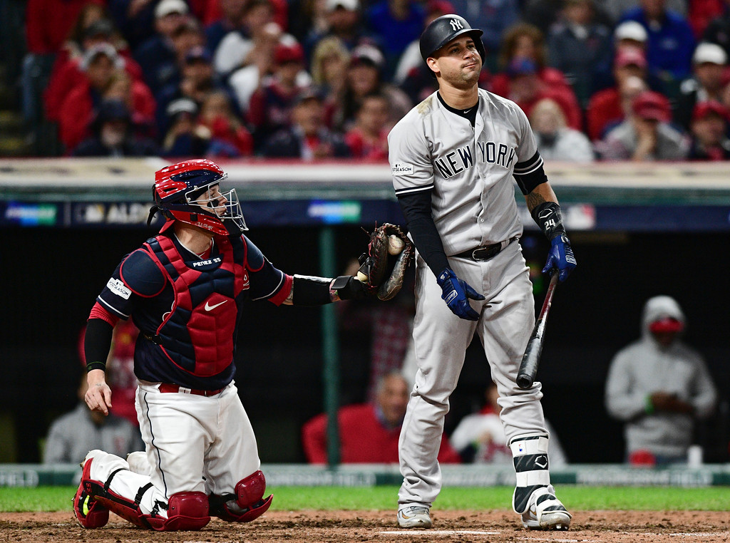 . New York Yankees\' Gary Sanchez is tagged out by Cleveland Indians catcher Roberto Perez after striking out in the eighth inning of Game 5 of baseball\'s American League Division Series, Wednesday, Oct. 11, 2017, in Cleveland. (AP Photo/David Dermer)