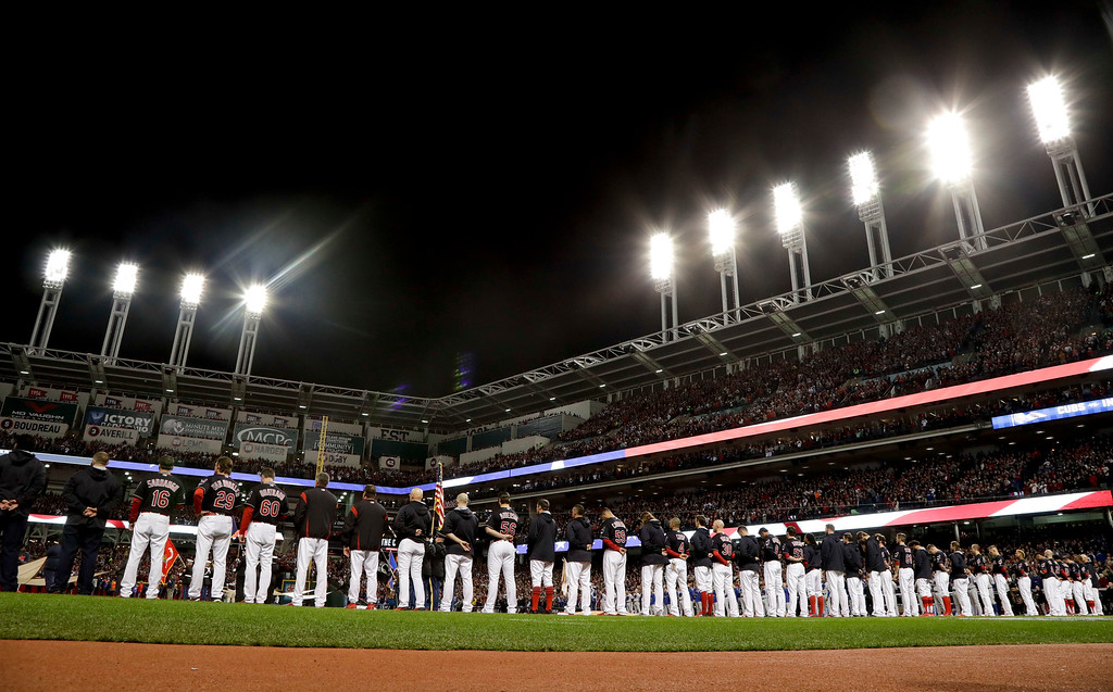 . Members of the Cleveland Indians line up for the national anthem before Game 1 of the Major League Baseball World Series against the Chicago Cubs Tuesday, Oct. 25, 2016, in Cleveland. It was the first World Series appearance for the Tribe since 1997. (AP Photo/Matt Slocum)