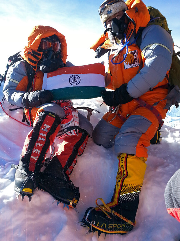 . In this photograph received from the SOCIAL WELFARE RESIDENTIAL EDUCATIONAL INSTITUTIONS SOCIETY on June 2, 2014 and taken on May 25, 2014, Indian mountaineer Poorna Malavath (L) sits at the summit of Mount Everest. AFP PHOTO/SOCIAL WELFARE RESIDENTIAL EDUCATIONAL INSTITUTIONS SOCIETY/AFP/Getty Images