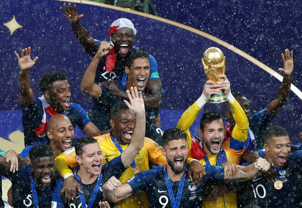 . France players celebrate with the trophy after defeating Croatia in the final at the 2018 soccer World Cup in the Luzhniki Stadium in Moscow, Russia, Sunday, July 15, 2018. (AP Photo/Rebecca Blackwell)