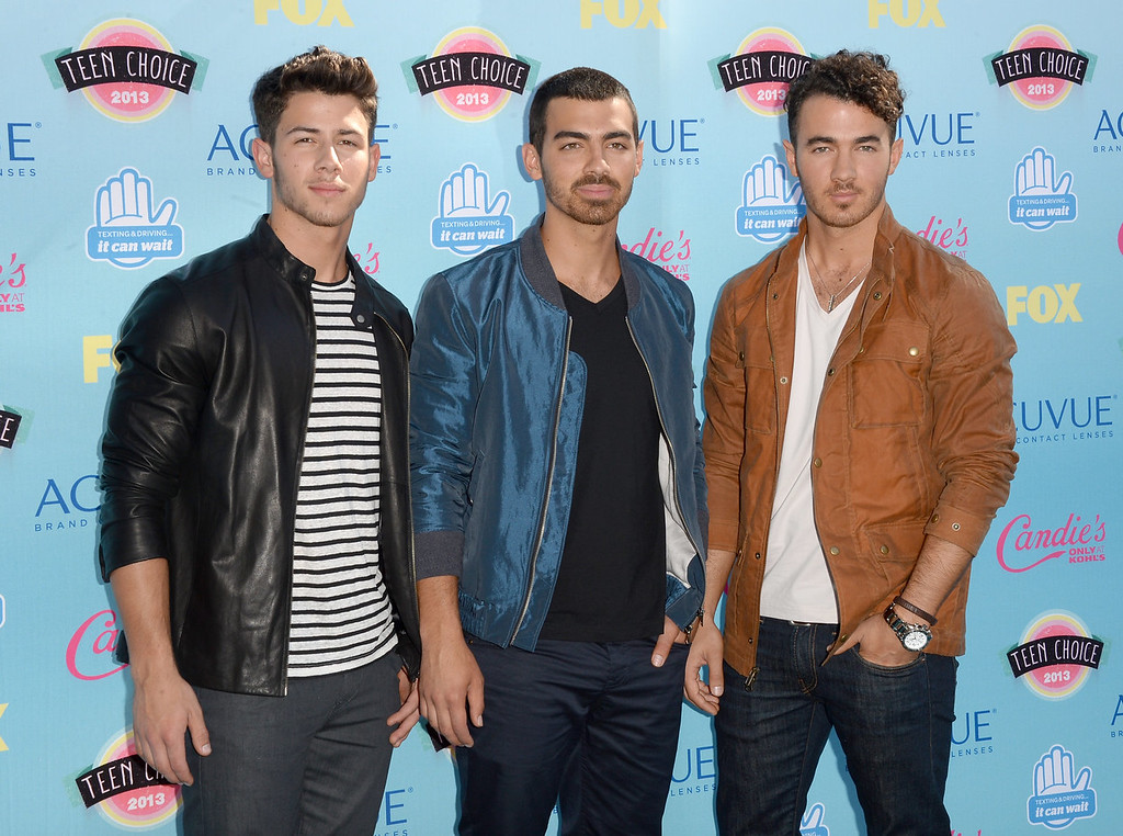 . (L-R) Musicians Nick Jonas, Joe Jonas and Kevin Jonas of the Jonas Brothers attend the Teen Choice Awards 2013 at Gibson Amphitheatre on August 11, 2013 in Universal City, California.  (Photo by Jason Merritt/Getty Images)
