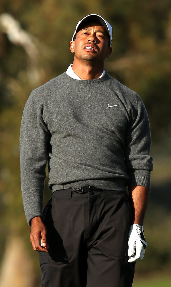. Tiger Woods reacts to his tee shot on the second hole during the final round of the Farmers Insurance Open on the South Course at Torrey Pines Golf Course on January 27, 2013 in La Jolla, California.  (Photo by Stephen Dunn/Getty Images)