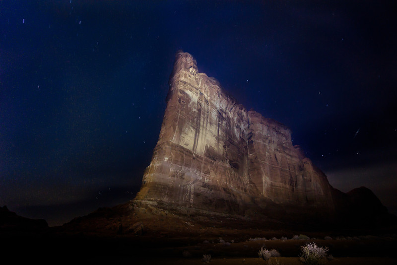 A 181 second exposure at ISO 800 @ f 5.6. The 700 foot tall Tower of Babel in Arches National Park was illuminated by two powerful spotlights, one in each hand.