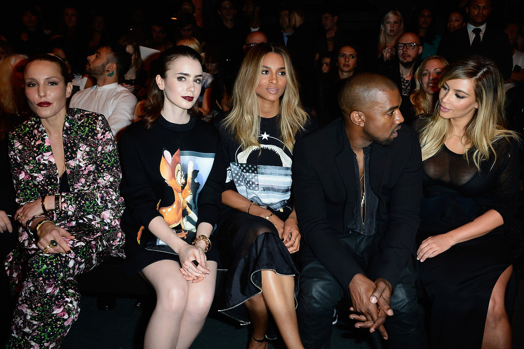 . PARIS, FRANCE - SEPTEMBER 29: Actresses Noomi Rapace, Lily Collins, singer Ciara, Kanye West and Kim Kardashian attend the Givenchy show as part of the Paris Fashion Week Womenswear  Spring/Summer 2014 on September 29, 2013 in Paris, France.  (Photo by Pascal Le Segretain/Getty Images)