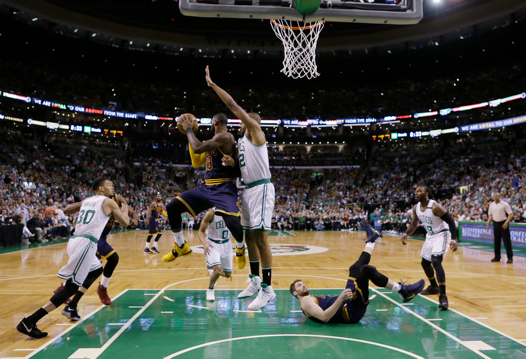 . Cleveland Cavaliers forward LeBron James (23) looks to pass the ball as he drives against Boston Celtics center Al Horford (42) during the first half of Game 2 of the NBA basketball Eastern Conference finals, Friday, May 19, 2017, in Boston. (AP Photo/Elise Amendola)