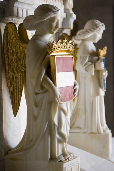 Marble statue from a child prince's tomb at El Escorial, Spain. According to the desire of the king Philip II, most Spanish sovereigns, beginning with the emperor Charles V and Philip II himself, were buried at El Escorial.