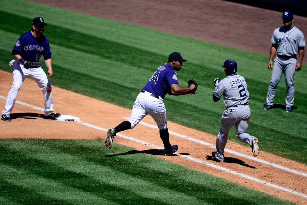 . Colorado Rockies starting pitcher Juan Nicasio (44) makes a tag on San Diego Padres shortstop Everth Cabrera (2) during the action in Denver. The Colorado Rockies hosted the San Diego Padres at Coors Field on Sunday, June 9, 2013. (Photo by AAron Ontiveroz/The Denver Post)
