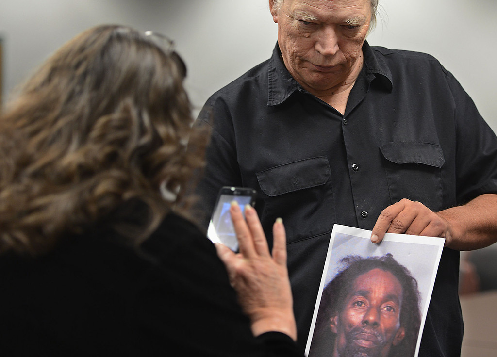 . Phillip Kelley holds a photo of murder suspect of Jerome Anthony Rogers, 55, of San Bernardino, as his wife Nancy Kelley takes a photo. Kelley is the son of murder victim Josephine Kelley. Rogers was arrested Friday and booked into West Valley Detention Center in Rancho Cucamonga in the killing of Mary Beth Blaskey. The Kelley\'s say they\'re hopefully with Friday\'s arrest that their mother\'s killer will be found. Rick Sforza/Staff photographer