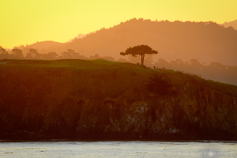 Pebble Beach - looking across the bay to the 7th tee box at sunrise.