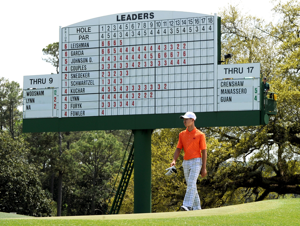 Description of . Tianlang Guan of China walks to the 18th green during the second round of the 77th Masters golf tournament at Augusta National Golf Club on April 12, 2013 in Augusta, Georgia.   DON EMMERT/AFP/Getty Images