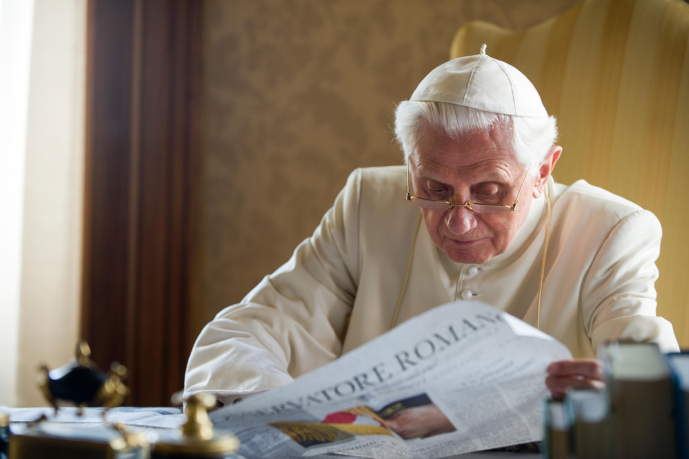 Description of . Pope Benedict XVI has announced that he is to resign on February 28, 2013 CASTEL GANDOLFO, ITALY - JULY 26:    Pope Benedict XVI reads papers in his  summer residence on July 26, 2010 in Castel Gandolfo, near Rome, Italy.  The Pontiff will visit England from September 16 - 19. (Photo by  L'Osservatore Romano - Vatican Pool via Getty Images)