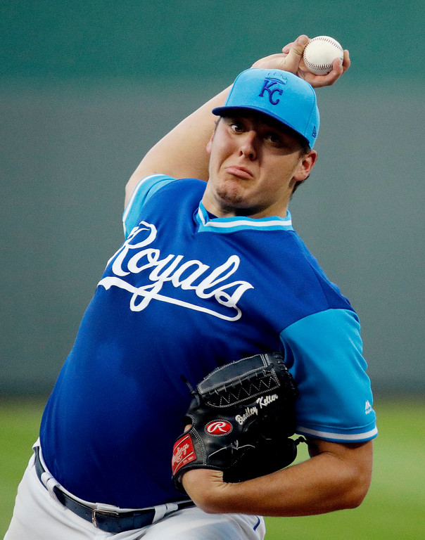 . Kansas City Royals starting pitcher Brad Keller throws during the first inning of the team\'s baseball game against the Cleveland Indians on Friday, Aug. 24, 2018, in Kansas City, Mo. (AP Photo/Charlie Riedel)