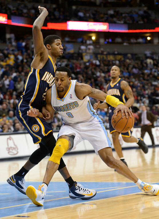 . DENVER, CO. - JANUARY 28: Denver Nuggets shooting guard Andre Iguodala (9) runs in to Indiana Pacers small forward Paul George (24) as he drives to the basket in the third quarter January 28, 2013 at Pepsi Center. The Denver Nuggets defeated  the Indiana Pacers 102-101 in NBA Action. (Photo By John Leyba / The Denver Post)