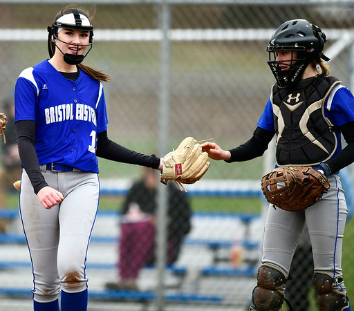 4/9/2019 Mike Orazzi   Staff Bristol Eastern's Erin Girard (13) and Paige McLaughlin (2) during Tuesday's softball game with Southington in Bristol.