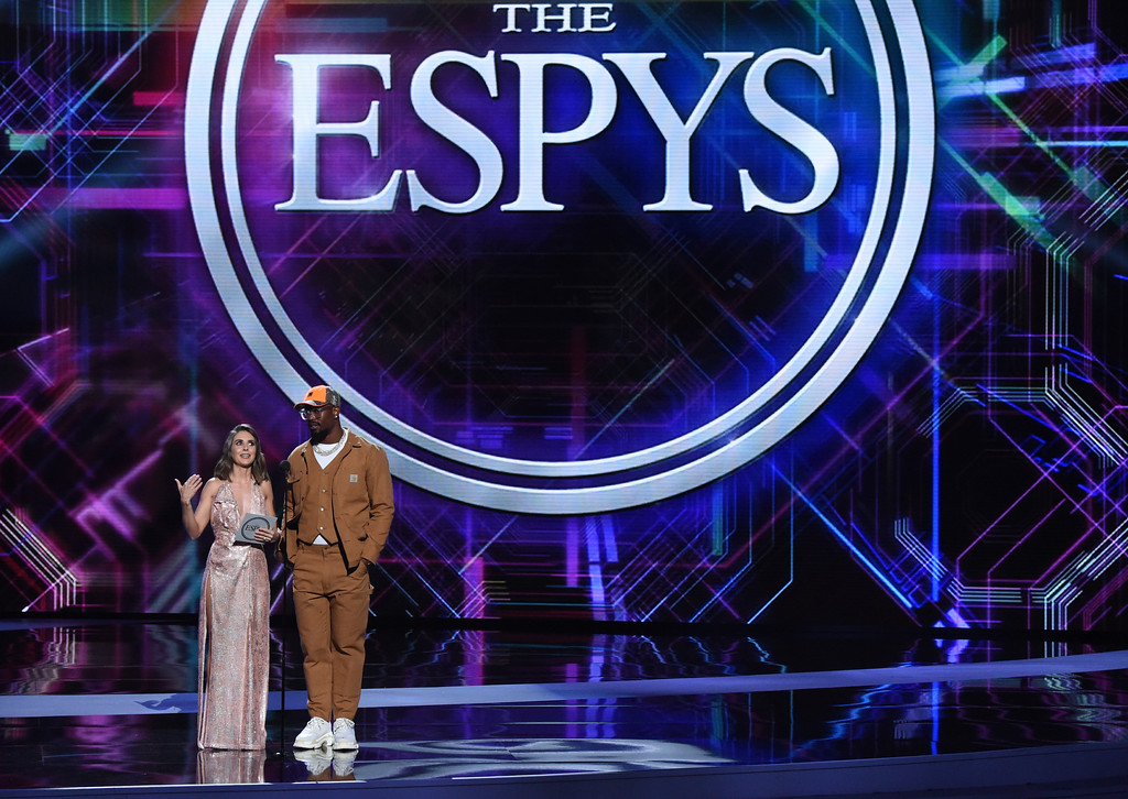 . Denver Broncos\' Von Miller, right, and Alison Brie present the award for best team at the ESPY Awards at Microsoft Theater on Wednesday, July 18, 2018, in Los Angeles. (Photo by Phil McCarten/Invision/AP)