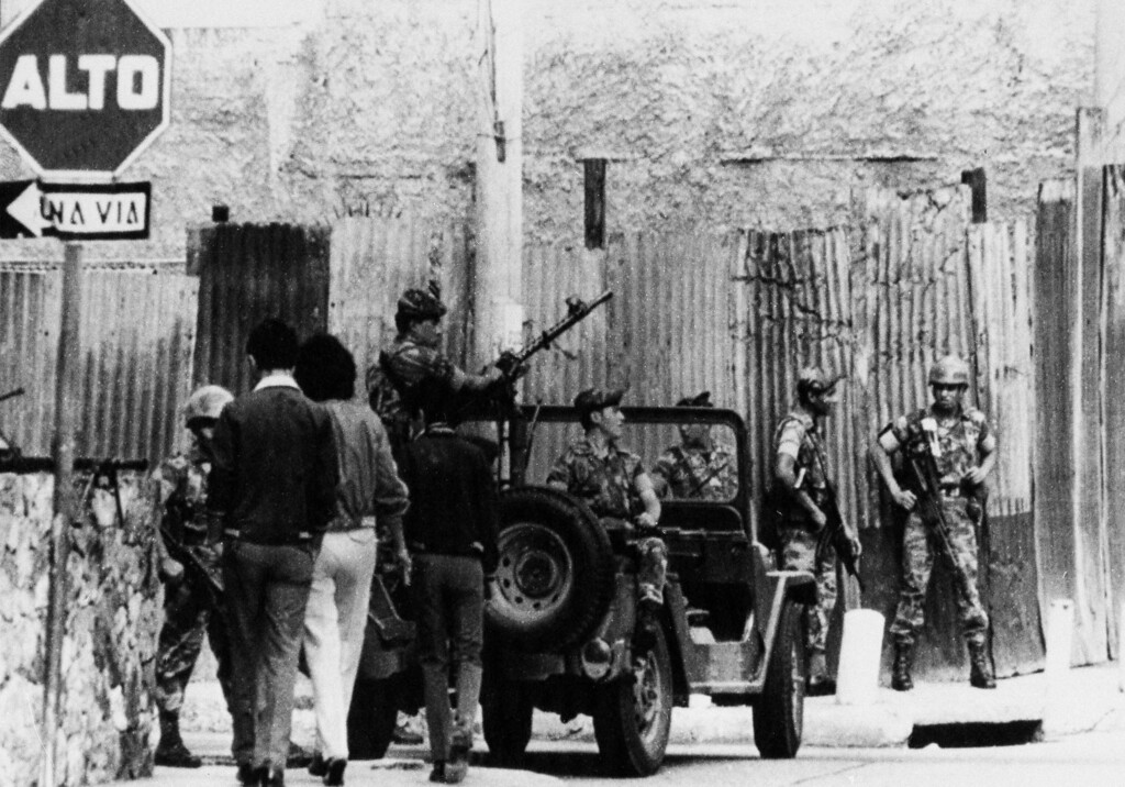 . Soldiers in a jeep block one of the streets of the National Palace, stopping the civilians from passing through, in Guatemala City, Aug. 8, 1983. Earlier, the military announced that Gen. Oscar Mejia Victores will replace Efrain Rios Montt as president of Guatemala, the National Radio reported. (AP Photo)
