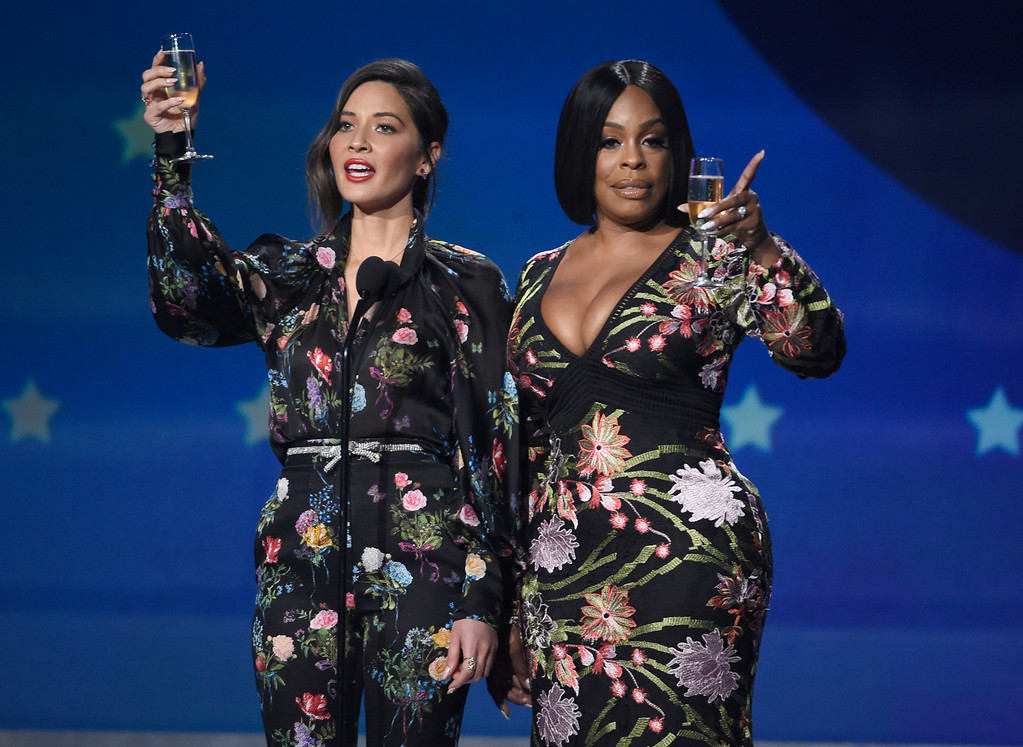 . Host Olivia Munn, left, and Niecy Nash speak at the 23rd annual Critics\' Choice Awards at the Barker Hangar on Thursday, Jan. 11, 2018, in Santa Monica, Calif. (Photo by Chris Pizzello/Invision/AP)
