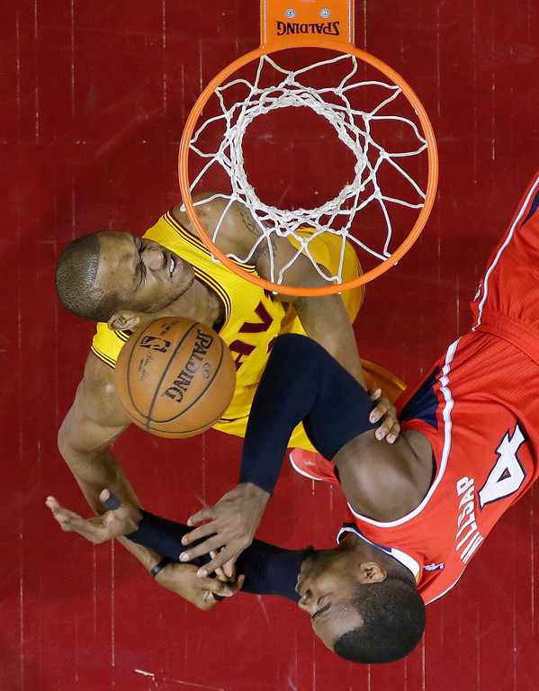 . Cleveland Cavaliers forward James Jones (1) battles for a rebound against Atlanta Hawks forward Paul Millsap (4) in the second half of Game 4 of the NBA basketball Eastern Conference Finals, Tuesday, May 26, 2015, in Cleveland. (AP Photo/Tony Dejak)