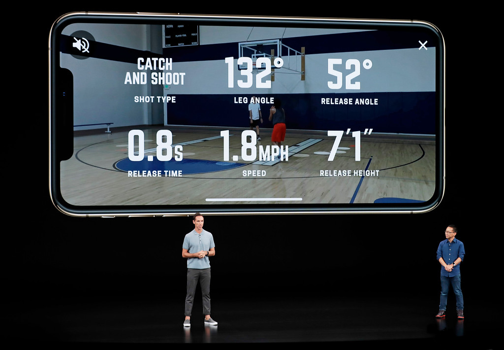 . CEO and founder of HomeCourt David Lee, right, and former NBA player Steve Nash talk about the Apple iPhone XS at the Steve Jobs Theater during an event to announce new Apple products Wednesday, Sept. 12, 2018, in Cupertino, Calif. (AP Photo/Marcio Jose Sanchez)