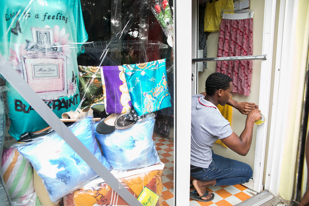 . A man puts tape on a store\'s glass doors before the arrival of Hurricane Irma in Las Terrenas, Dominican Republic, Wednesday, Sept. 6, 2017. Dominicans are getting ready for the arrival of Hurricane Irma after battering Puerto Rico with heavy rain and powerful winds, leaving more than 600,000 people without power as authorities struggle to get aid to small Caribbean islands already devastated by the historic storm. (AP Photo/Tatiana Fernandez)