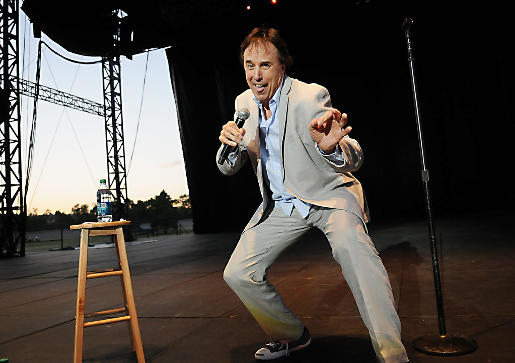 """. Comedian and actor Kevin Nealon, who appeared on \""""Saturday Night Live\"""" and other television shows, performs at the Minnesota State Fair Grandstand with other SNL alumni Dana Carvey and Dennis Miller on Thursday night, Aug. 22, 2013. (Pioneer Press: John Autey)"""