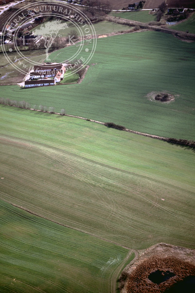 Farmland west of Ravlunda church - with plantations, buildings and prehistoric remains (2 April, 1989). | LH.0534