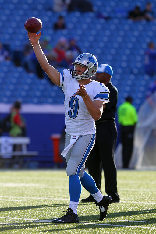 . Detroit Lions quarterback Matthew Stafford (9) warms up before a preseason NFL football game against the Buffalo Bills, Thursday, Aug. 28, 2014, in Orchard Park, N.Y. (AP Photo/Bill Wippert)