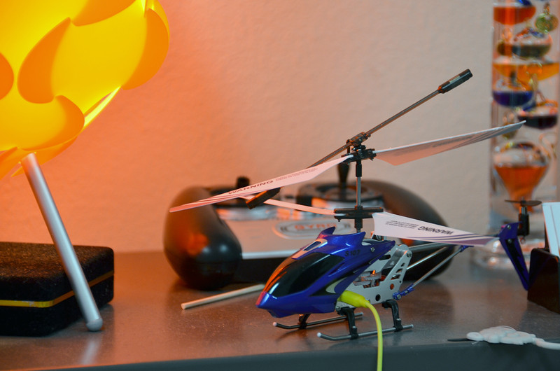 2012-3-13 ––– Just above my monitor at work I have this little remote control helicopter sitting on a shelf charging (yellow cord). If I need a break I take it for a short flight. It is truly a short flight. I can get 3 to 4 minutes of full power and then it can hardly get off the ground. A fun diversion.