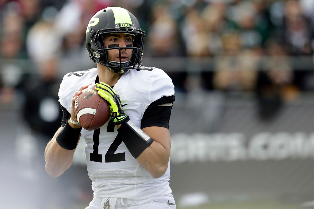 . Purdue quarterback Austin Appleby ooks to pass against Michigan State during the first half of an NCAA college football game in West Lafayette, Ind., Saturday, Oct. 11, 2014. Michigan State won 45-31. (AP Photo/AJ Mast)