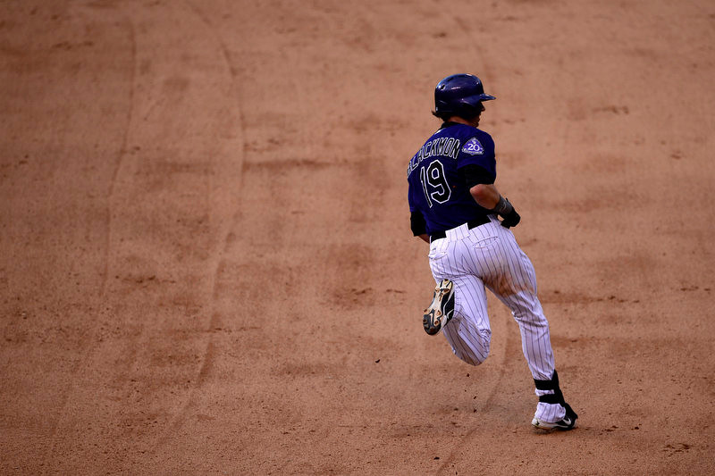. Charlie Blackmon (19) of the Colorado Rockies rounds first en route to a double against the Los Angeles Dodgers during the Dodgers\' 10-8 win in Denver on Monday, September 2, 2013. The Colorado Rockies hosted the Los Angeles Dodgers at Coors Field. (Photo by AAron Ontiveroz/The Denver Post)