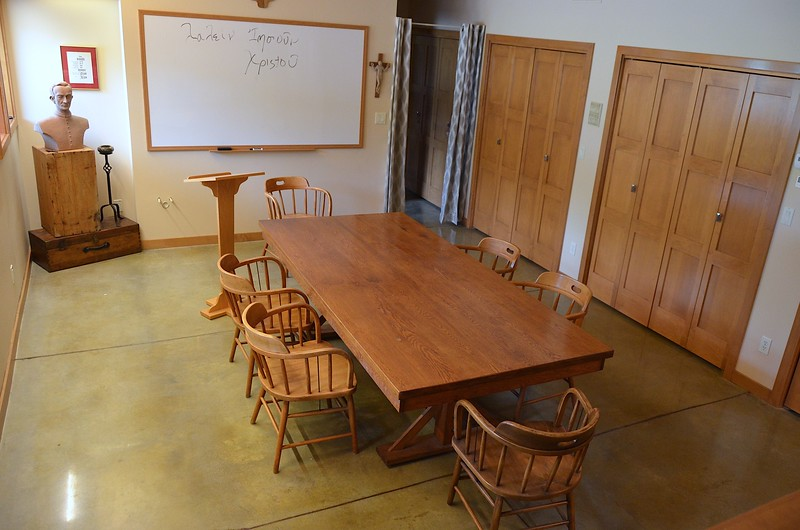 What was once a basement recreation room is now a classroom. Fr. Byron found the table at a second-hand store and the chairs at a rummage sale.