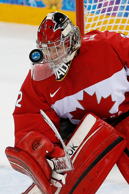 . Goalkeeper Charline Labonte of Canada keeps an eye on the puck during the 2014 Winter Olympics women\'s ice hockey game against the United States at Shayba Arena, Wednesday, Feb. 12, 2014, in Sochi, Russia. (AP Photo/Petr David Josek)
