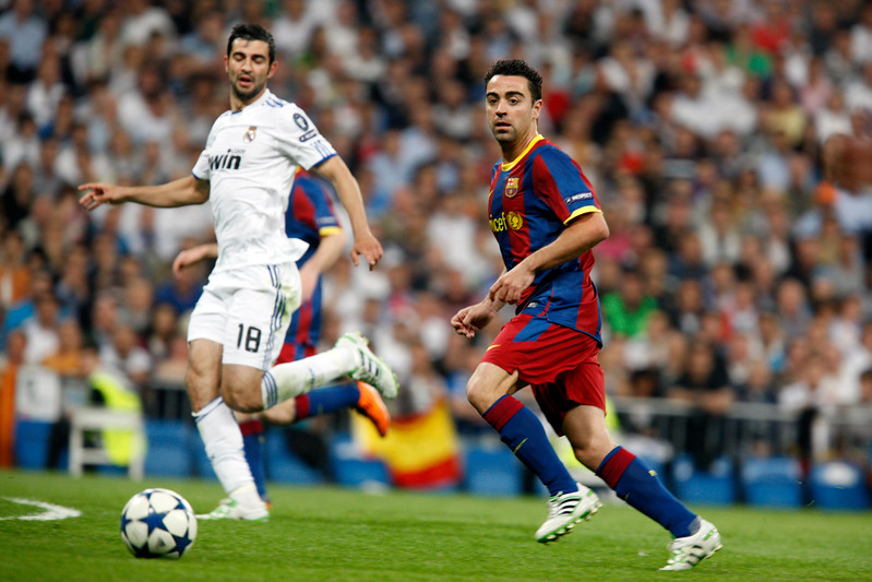 Xavi looking at the ball after having passed it, UEFA Champions League Semifinals game between Real Madrid and FC Barcelona, Bernabeu Stadiumn, Madrid, Spain