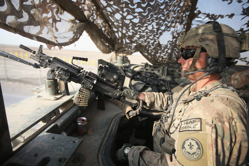 . SGT Matt Farkas from Sierra Vista, Arizona a medic with the U.S. Army\'s 4th squadron 2d Cavalry Regiment mans a machine gun at the back of a Stryker during a patrol on February 25, 2014 near Kandahar, Afghanistan.    (Photo by Scott Olson/Getty Images)